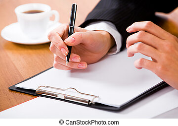 Ready to write - Close-up of businesswoman�s hand holding ...