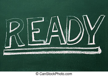 ready, word in white chalk handwriting on blackboard