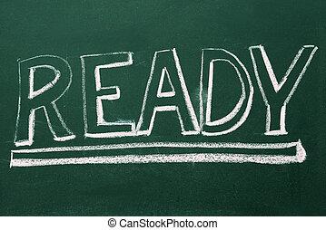 ready, word in white chalk handwriting on blackboard