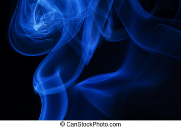 Real blue smoke on black background