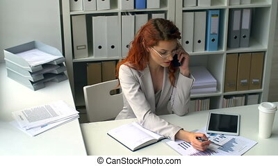 Real Busy - High angle of attractive business woman talking...