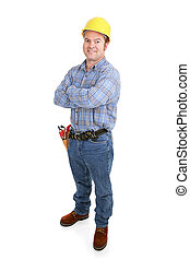 Authentic construction worker smiling with arms crossed. Isolated on white.