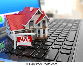 Real estate agency online. House on laptop keyboard.