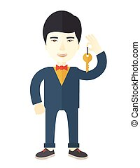 Real estate agent. - An asian real estate agent holding key ...
