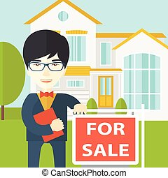 Real estate agent. - An asian real estate agent in glasses ...