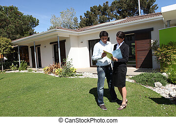 Real estate agent doing a viewing