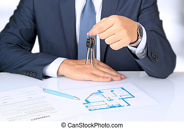 Real-estate agent giving a key