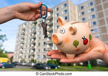Real estate agent giving flat keys to a new property owner,...
