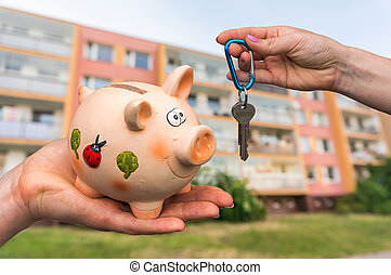 Real estate agent giving home keys to a new property owner,...