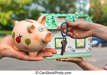 Real estate agent giving house keys to a new property owner,...