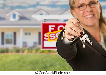 Real Estate Agent Handing Over New House Keys with Sold Sign Behind
