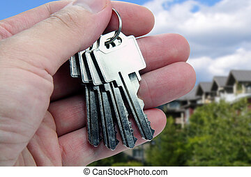 hands over the keys - Real Estate agent hands over the keys.