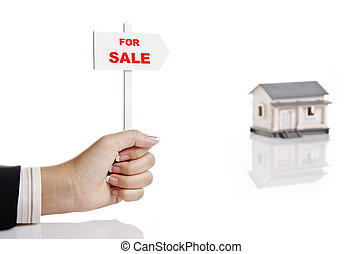 real estate agent holding sign