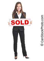 Real estate agent holding sold sign. Isolated in full length...