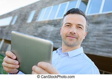 real estate agent holding tablet
