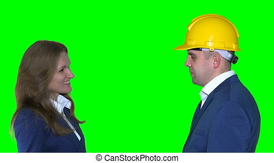 real estate agent man with helmet give new flat house keys to happy client woman
