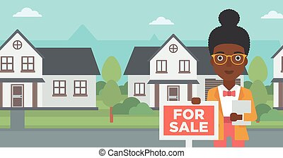 Real estate agent offering house. - An african-american real...