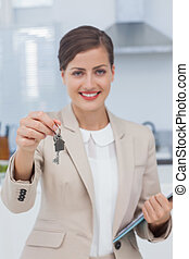 Real estate agent offering house key in a new house