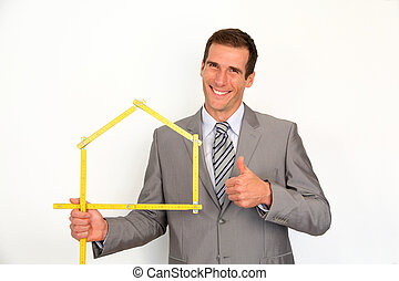 Real estate agent promoting house
