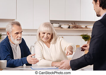 Real estate agent selling the house to aged couple