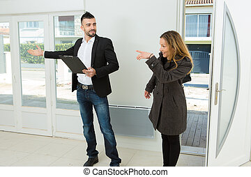 real estate agent showing apartment