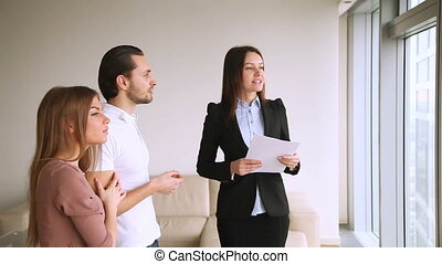 Real estate agent showing flat and infrastructure nearby to...