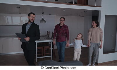 Real estate agent showing to owners new and beautiful house
