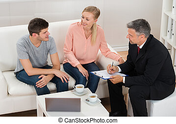 Real Estate Agent Talking To Couple
