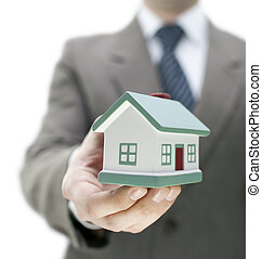 Real estate agent with a toy house - Real estate agent ...