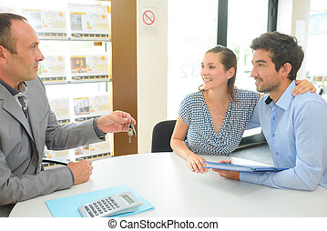 real estate agent with clients