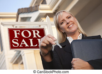 Real Estate Agent with Keys in Front of Sign and House -...