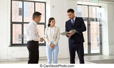 realtor with folder showing documents to customers - real...