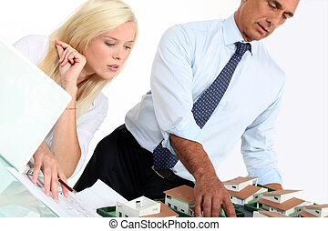 real estate businessman and his assistant working in the...