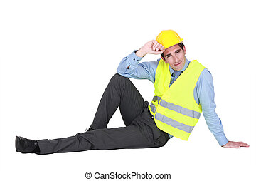 real estate businessman lying on the floor