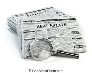 Real estate classifieds ads newspaper and magnifying glass isolated on white.