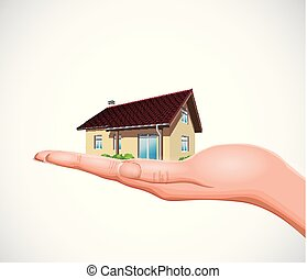 Real estate concept - house on hand