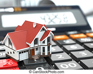 Real estate concept. House on calculator. Mortgage.