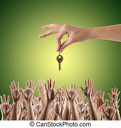 REAL ESTATE concept. Many hands want to get the key, reaching out for key - concept of winning a house, apartment. Close up view of hand holding key to a dream house. Clipping pass and copy space.