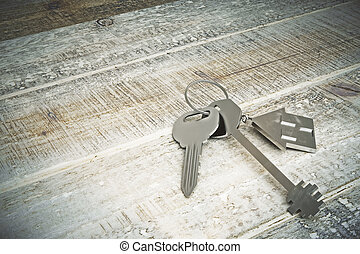 Real estate concept - Top view of metal keys with house...