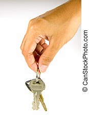 Real estate concept - woman hand holding house keys