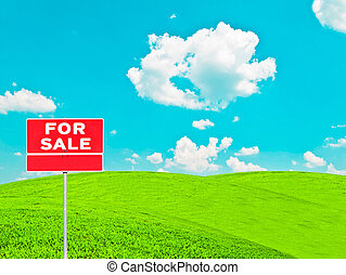 """Real estate conceptual image - """"FOR SALE"""" sign on empty meadow"""