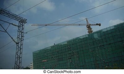 Real estate construction site.Altocumulus cloud in blue sky.Speeding train