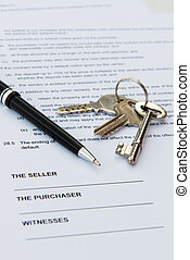 Real estate contract with pen and keys