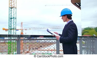 Real estate developer. New office construction. Confident business men or architect in front of modern office building.