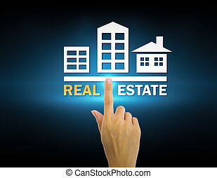 Hand and real estate sign with dark background.