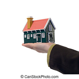 Miniature house in woman hand - isolated - real estate concept