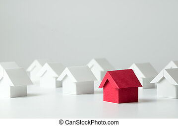 Real estate industry - Red house in among white houses for...