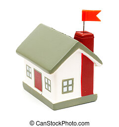 Real Estate - little house with flag isolated on white...