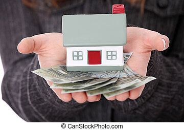 Real estate loan concept - Beautiful young businesswoman...