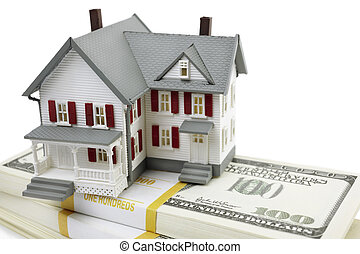 model of the house and us dollars on white background, selective focus, finance or rental concept